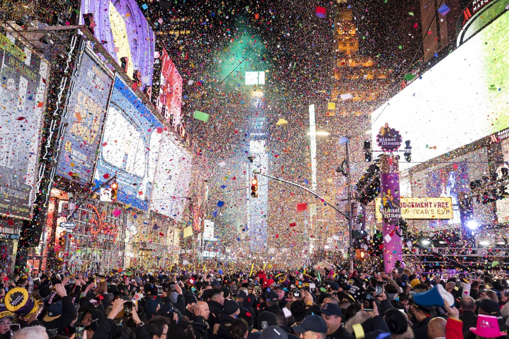 FILE - In this Jan. 1, 2020, file photo, confetti falls at midnight on the Times Square New Year's Eve celebration in New York. If ever a year's end s...