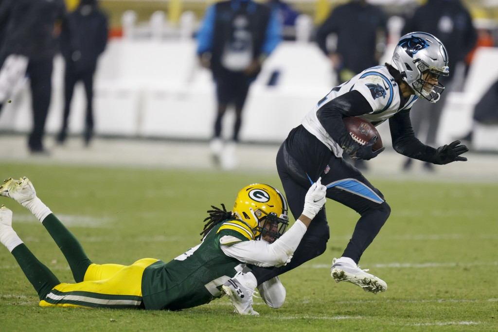 Green Bay Packers' Kevin King tries to stop Carolina Panthers' Robby Anderson during the second half of an NFL football game Saturday, Dec. 19, 2020, ...