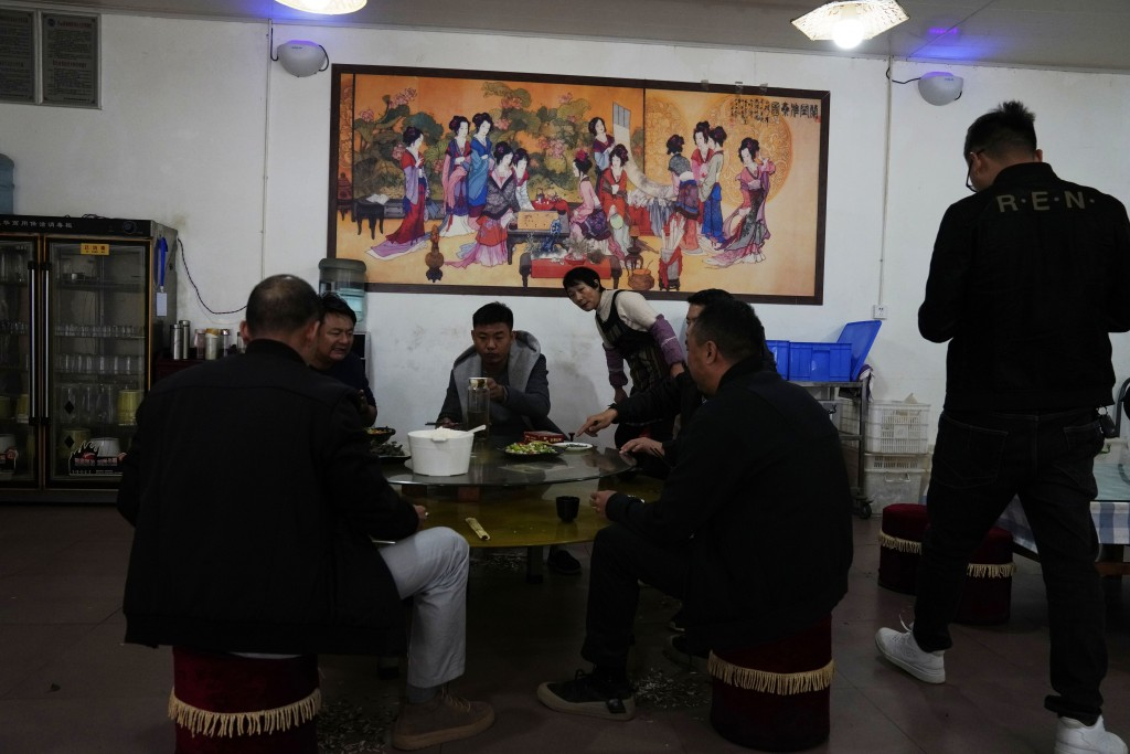 People eat in a restaurant outside of Kunming in southern China's Yunnan province on Monday, Nov. 30, 2020. More than a year since the first known per...