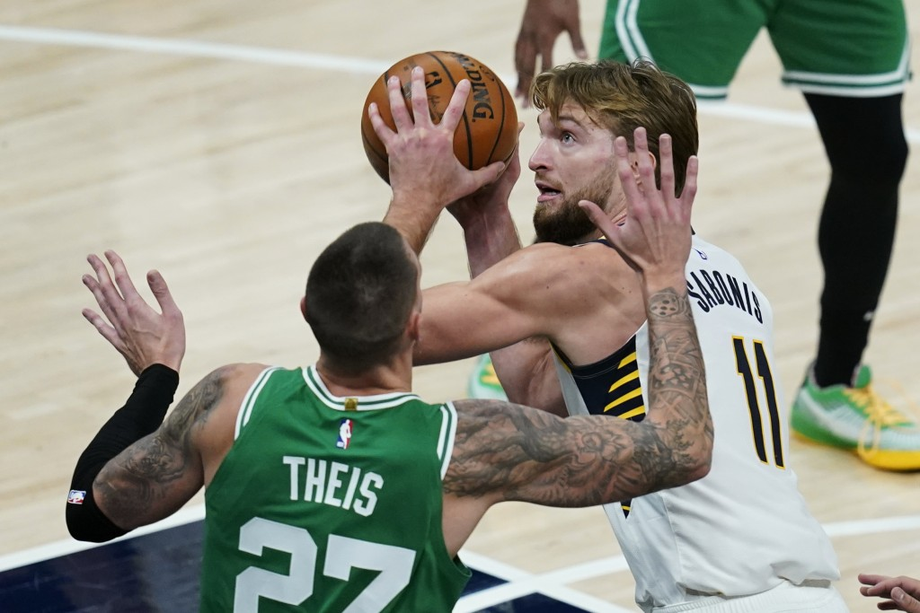 Indiana Pacers' Domantas Sabonis (11) goes to the basket against Boston Celtics' Daniel Theis (27) during the second half of an NBA basketball game Tu...