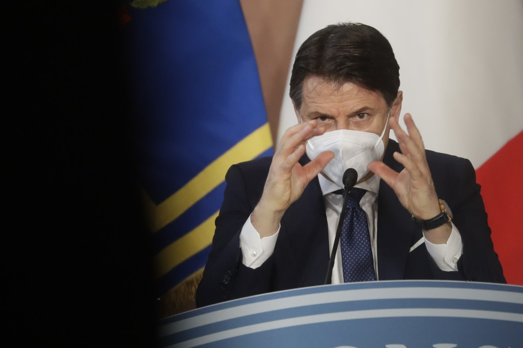 Italian Premier Giuseppe Conte gives his year end press conference, in Rome, Wednesday, Dec. 30, 2020. (AP Photo/Andrew Medichini)
