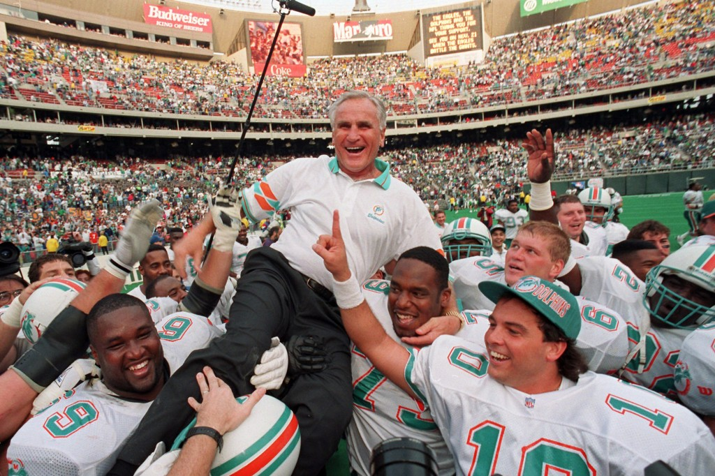 FILE - In this Nov. 14, 1993, file photo, Miami Dolphins coach Don Shula is carried on his team's shoulders after his 325th victory, against the Phila...