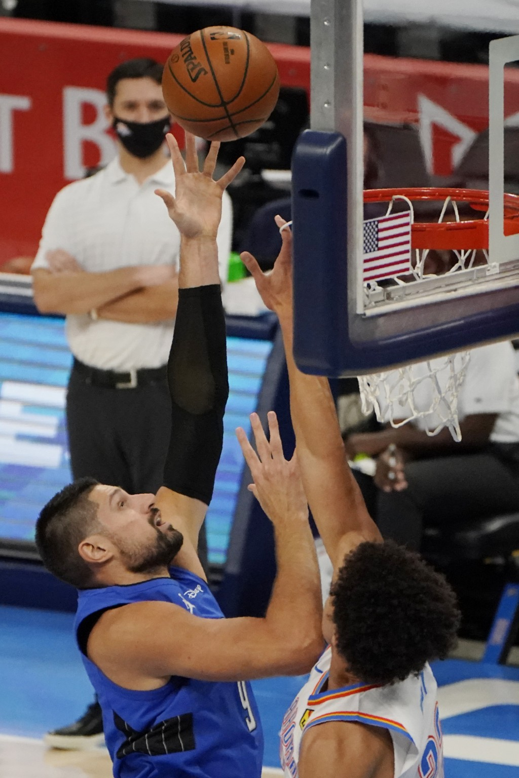 Orlando Magic center Nikola Vucevic (9) shoots over Oklahoma City Thunder forward Isaiah Roby, right, in the first half of an NBA basketball game Tues...