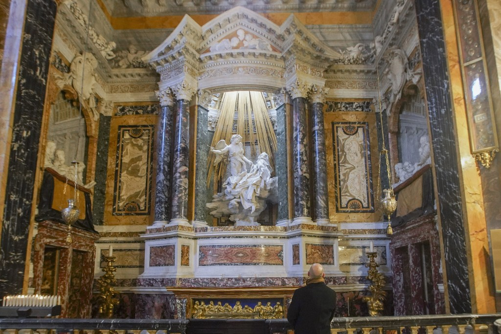"""A visitor admires the marble sculptural group """"Ecstasy of Saint Teresa"""" made between 1647 and 1652, by Baroque architect and sculptor Gian Lorenzo Ber..."""