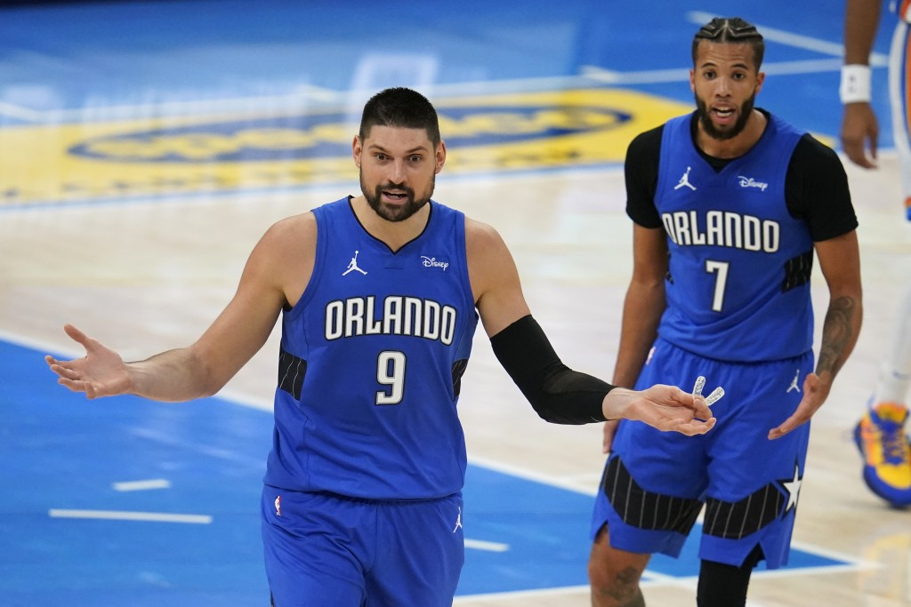 Orlando Magic center Nikola Vucevic (9) and guard Michael Carter-Williams (7) react to a call during the second half of the team's NBA basketball game...