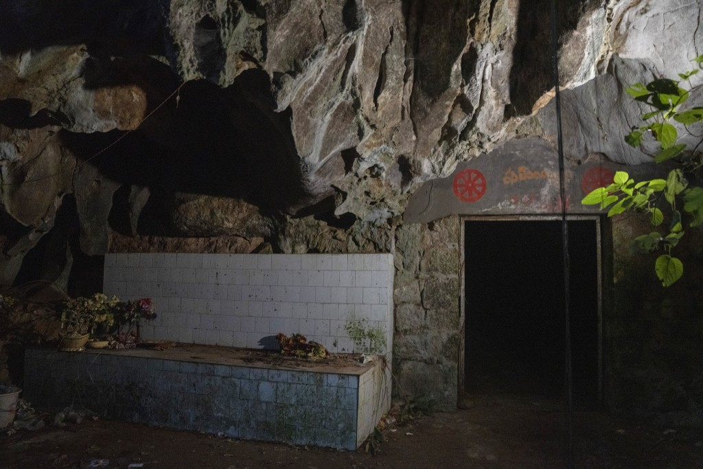 The entrance to the abandoned Wanling cave is littered with religious paraphernalia near Manhaguo village in southern China's Yunnan province on Wedne...