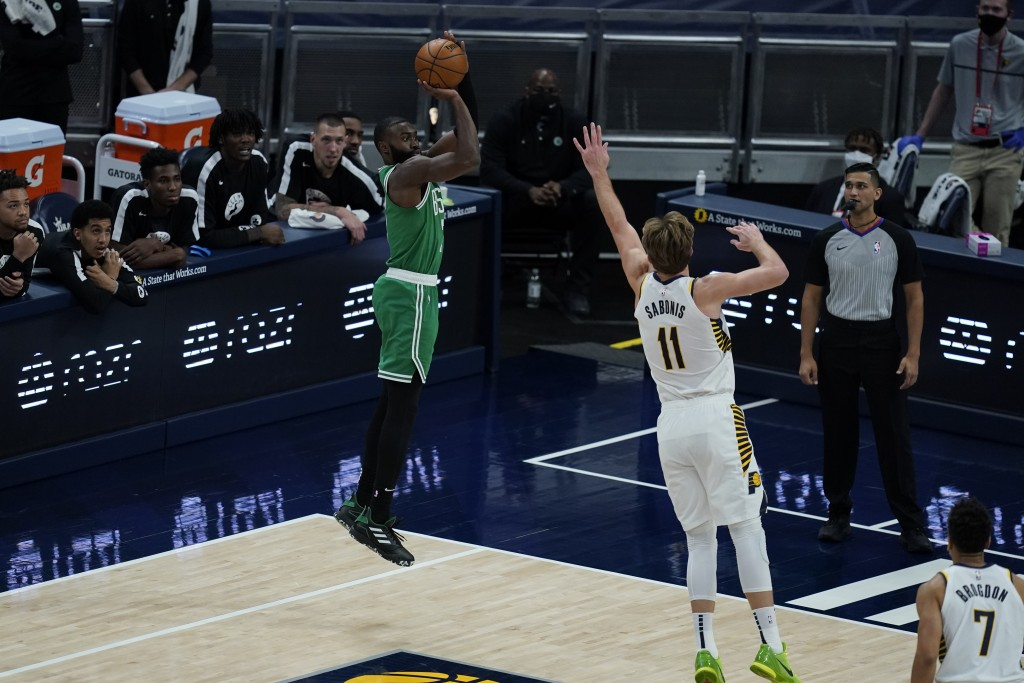Boston Celtics' Jaylen Brown (7) shoots over Indiana Pacers' Domantas Sabonis (11) during the second half of an NBA basketball game Tuesday, Dec. 29, ...
