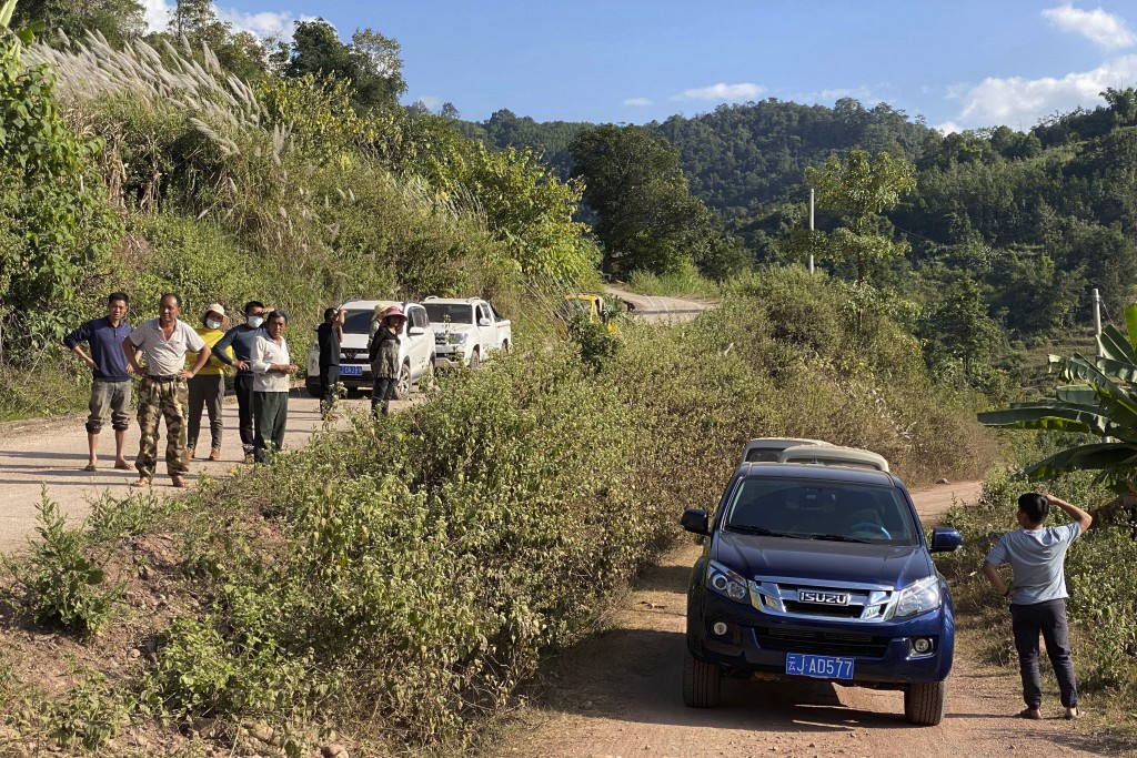 A group claiming to be local villagers use vehicles to block the roads leading to a mineshaft near Danaoshan in southern China's Yunnan province on Tu...