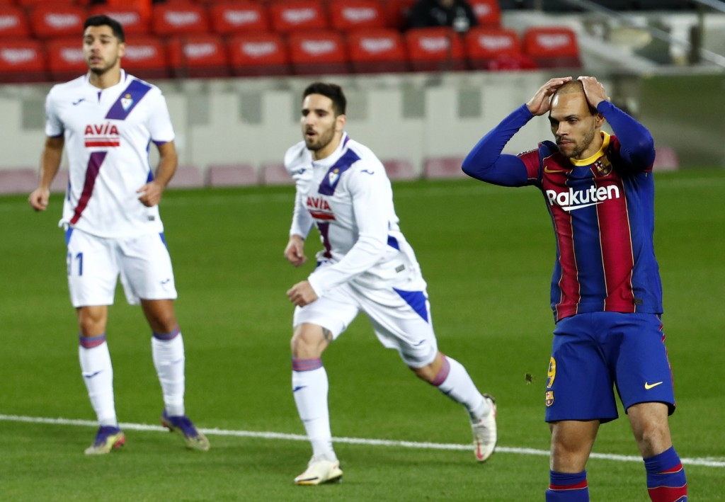 Barcelona's Martin Braithwaite reacts after missing to score from a penalty shot during the Spanish La Liga soccer match between Barcelona and Eibar a...