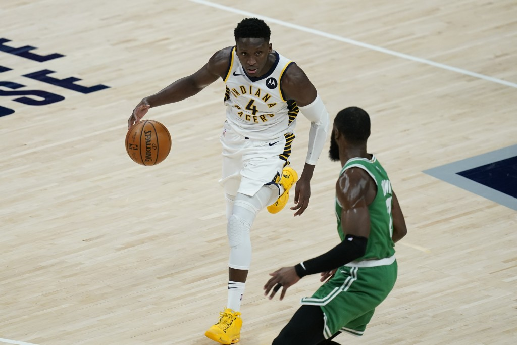 Indiana Pacers' Victor Oladipo (4) goes to the basket against Boston Celtics' Jaylen Brown (7) during the second half of an NBA basketball game, Tuesd...