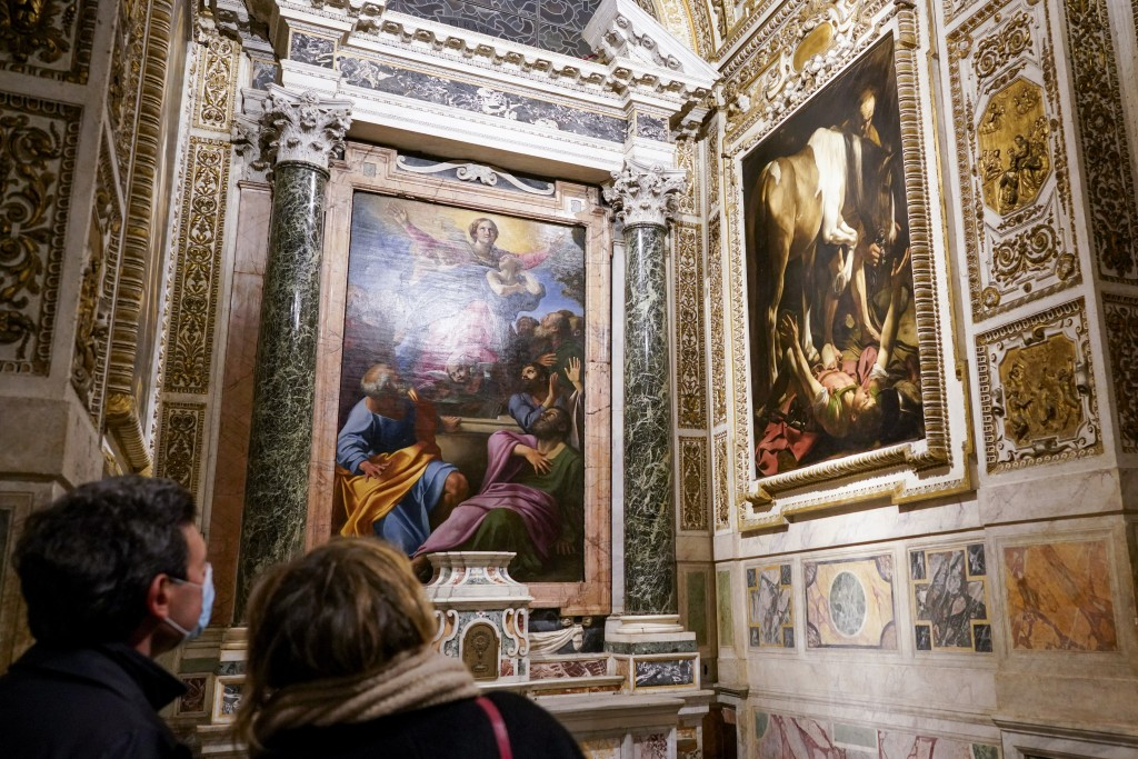 """Visitors admire the """"Conversion (of St. Paul) on the Way to Damascus"""", 1601, right, by Renaissance master Michelangelo Merisi, known as Caravaggio of ..."""