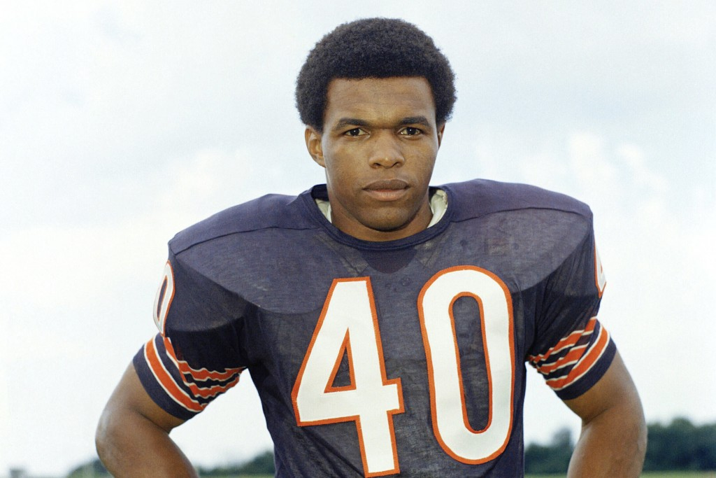 FILE - This is a 1970 file photo showing Chicago Bears football player Gale Sayers. Sports in 2020 was an unending state of mourning. Football lost a ...
