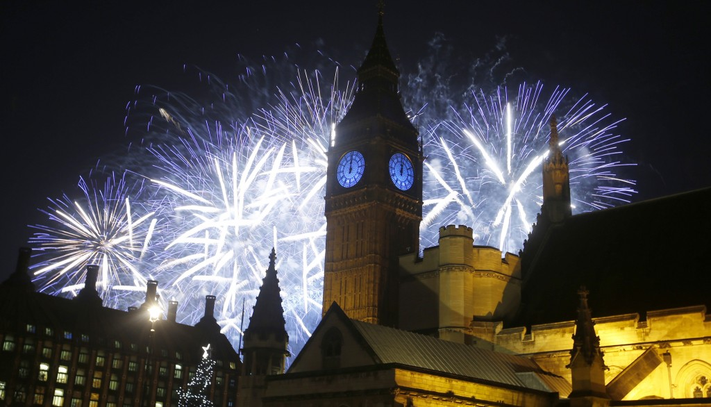 FILE - In this Friday, Jan. 1, 2016, file photo, fireworks explode over the River Thames and the Palace of Westminster's Elizabeth Tower, known as Big...