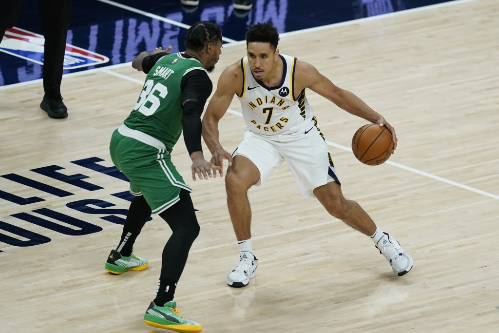 Indiana Pacers' Malcolm Brogdon (7) is defended by Boston Celtics' Marcus Smart (36) during the second half of an NBA basketball game, Tuesday, Dec. 2...