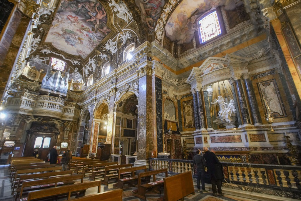 """Visitors admire the marble sculptural group """"Ecstasy of Saint Teresa"""" made between 1647 and 1652, by Baroque architect and sculptor Gian Lorenzo Berni..."""
