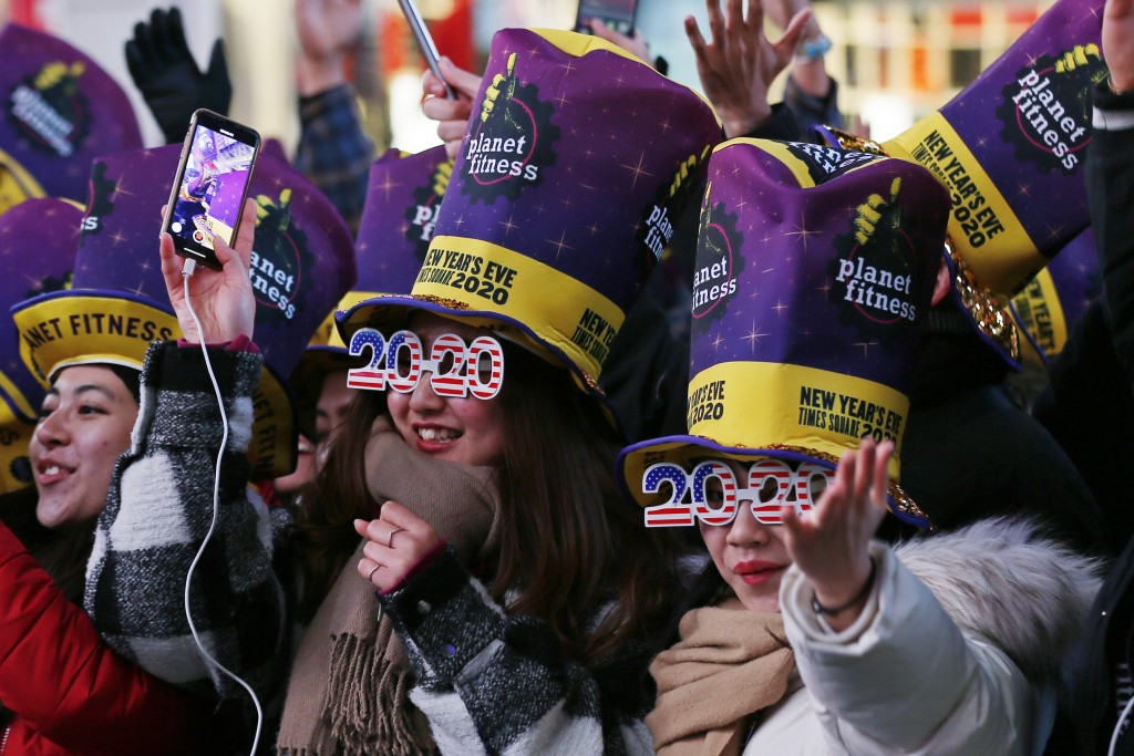FILE - In this Dec. 31, 2019, file photo, revelers cheer as they wait in New York's Times Square to take part in a New Year's Eve celebration. If ever...