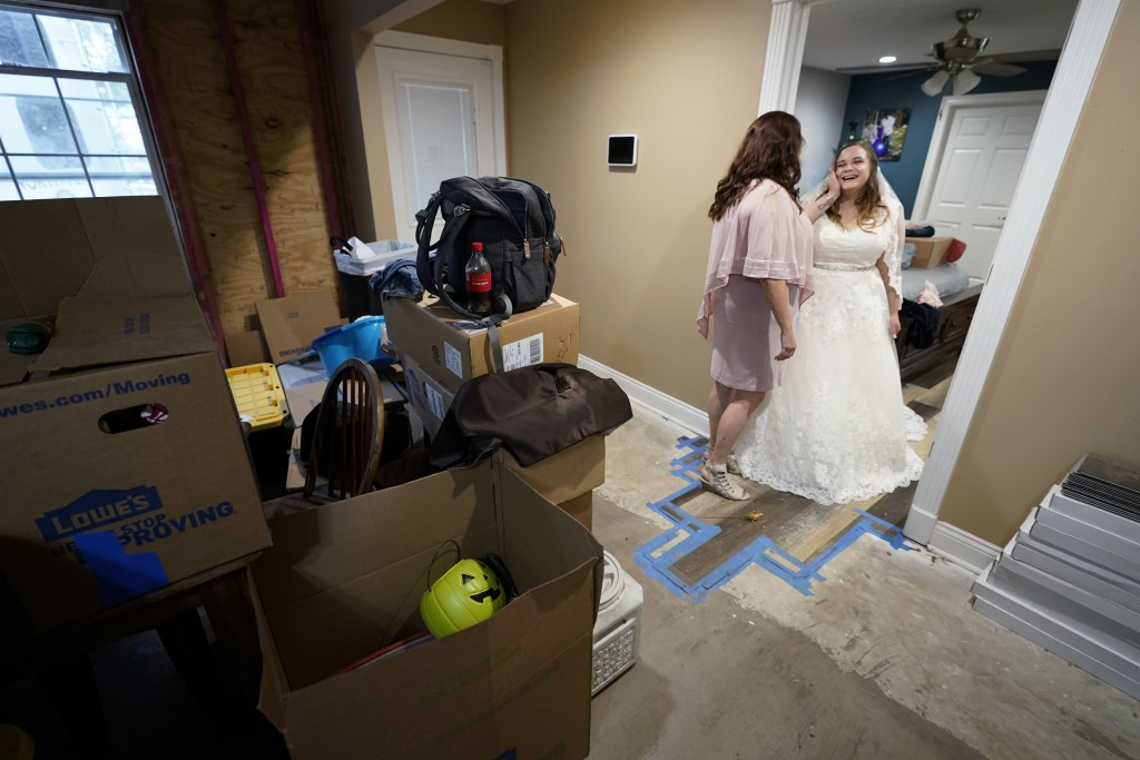 Nicole Caswell talks to her daughter Emily Pascale before her wedding, inside the home of Emily's now in-laws, Friday, Dec. 4, 2020,  Grand Lake, La.,...