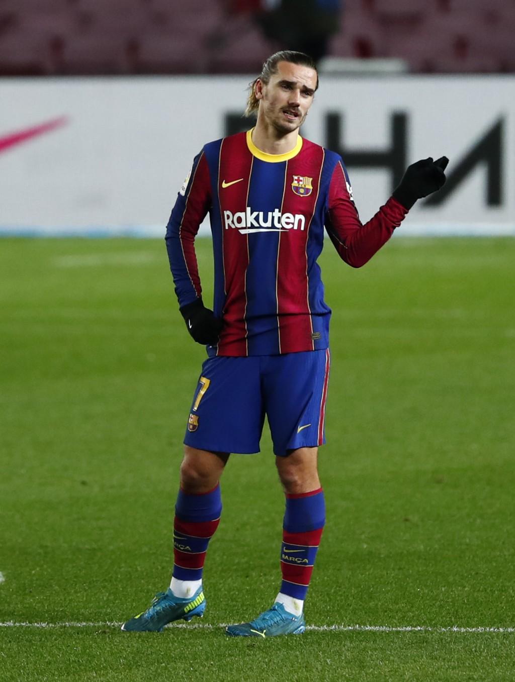 Barcelona's Antoine Griezmann gestures during the Spanish La Liga soccer match between Barcelona and Eibar at the Camp Nou stadium in Barcelona in Bar...