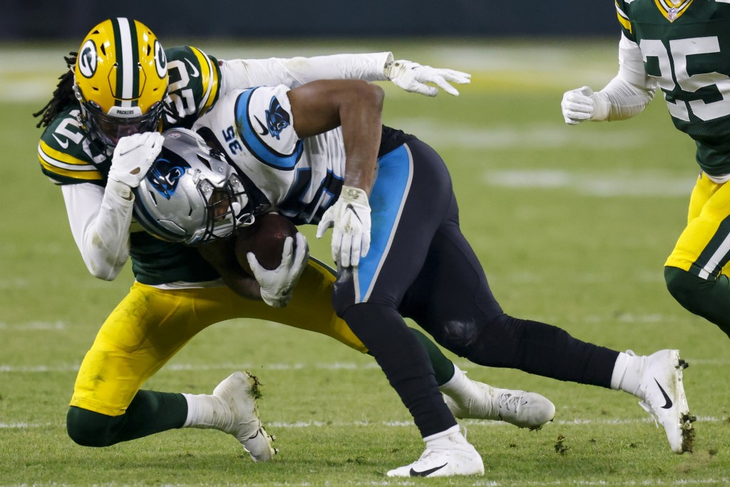 Green Bay Packers' Kevin King stops Carolina Panthers' Rodney Smith during the second half of an NFL football game Saturday, Dec. 19, 2020, in Green B...