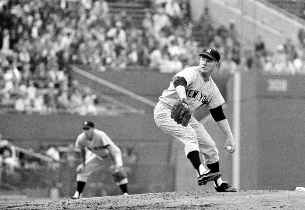 FILE - This Sept. 19, 1961, file photo shows New nYork Yankees' Whitey Ford throwing to Baltimore Orioles' Brooks Robinson during first inning action ...