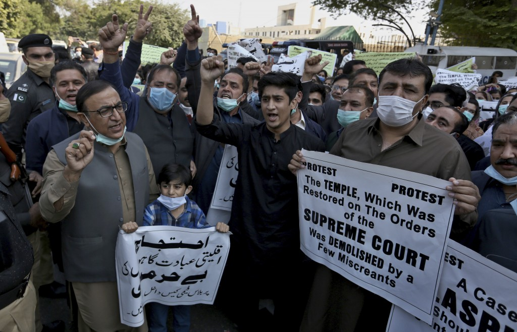 Members of Pakistan Hindu Council hold a protest against the attack on a Hindu temple in the northwestern town of Karak, in Karachi, Pakistan, Thursda...