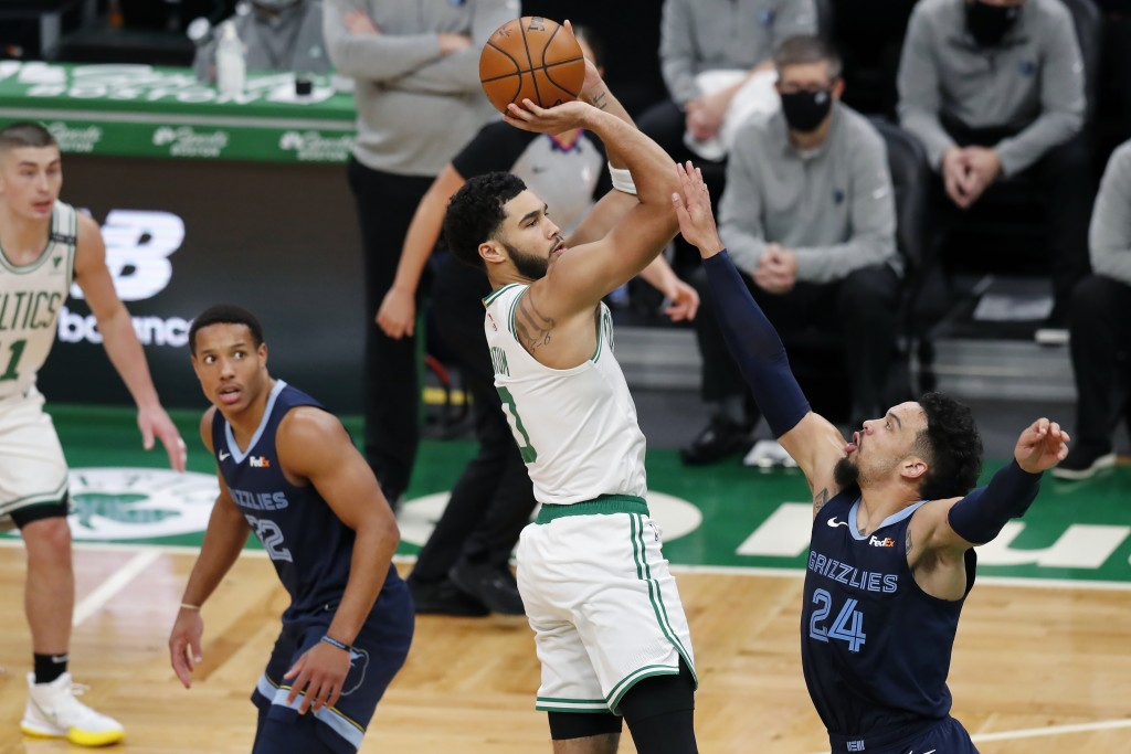 Boston Celtics' Jayson Tatum (0) shoots over Memphis Grizzlies' Dillon Brooks (24) during the first half of an NBA basketball game, Wednesday, Dec. 30...