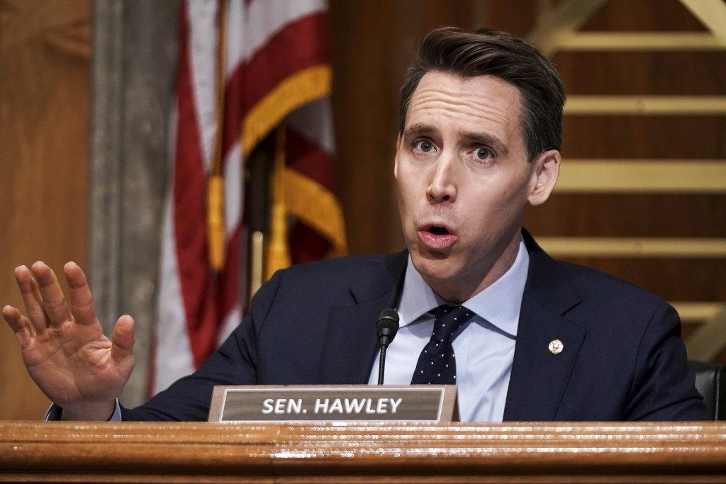 FILE - In this Dec. 16, 2020 file photo, Sen. Josh Hawley, R-Mo., asks questions during a Senate Homeland Security & Governmental Affairs Committee he...