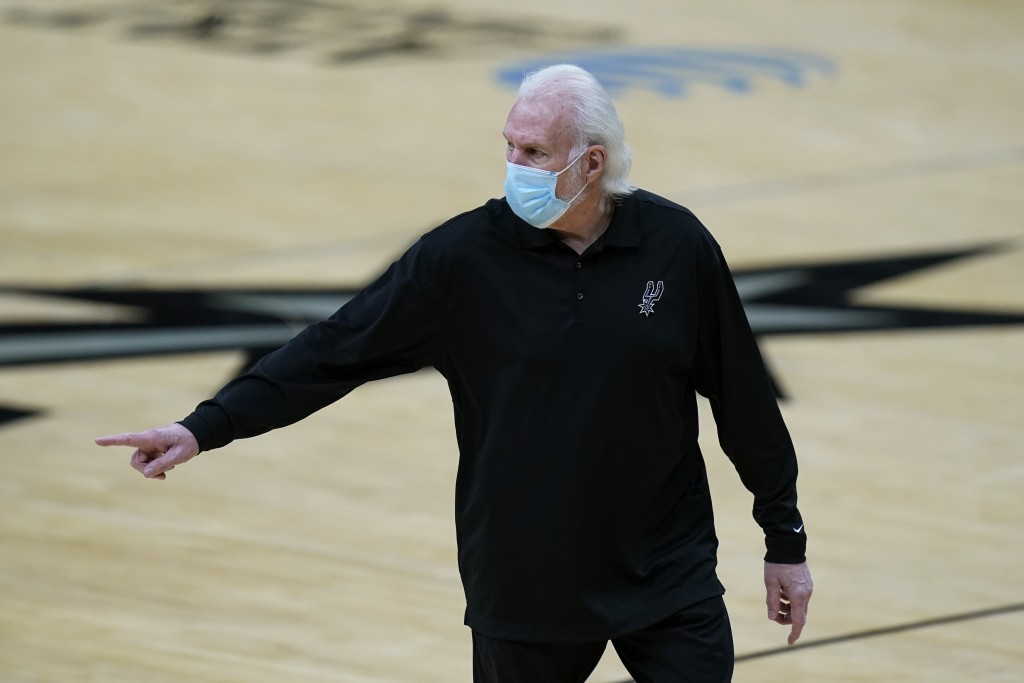 San Antonio Spurs coach Gregg Popovich walks off the court after he was ejected during the first half of the team's NBA basketball game against the Lo...