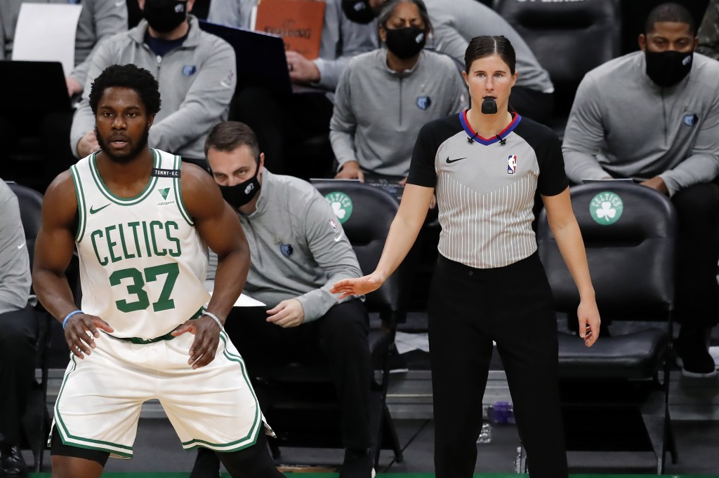 Referee Natalie Sago officiates behind Boston Celtics' Semi Ojeleye (37) during the first half of an NBA basketball game against the Memphis Grizzlies...