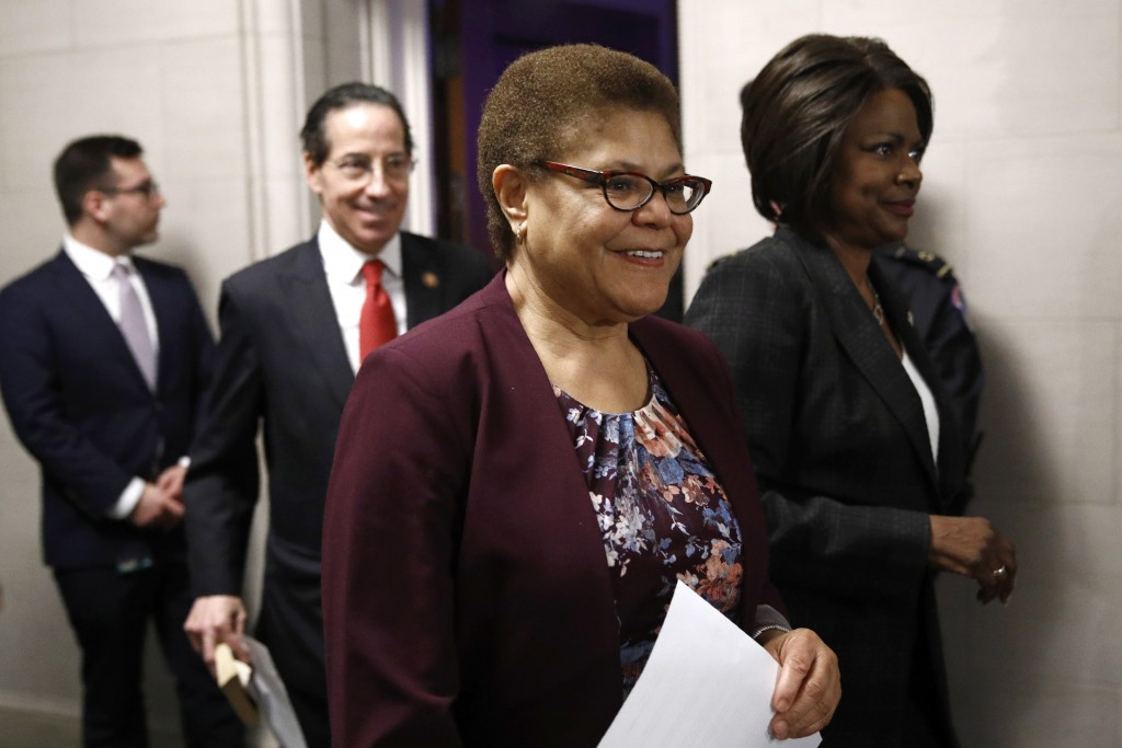 FILE - In this Dec. 9, 2019, file photo Rep. Karen Bass, D-Calif., center, walks out of a hearing room with Rep. Jamie Raskin, D-Md., second from left...