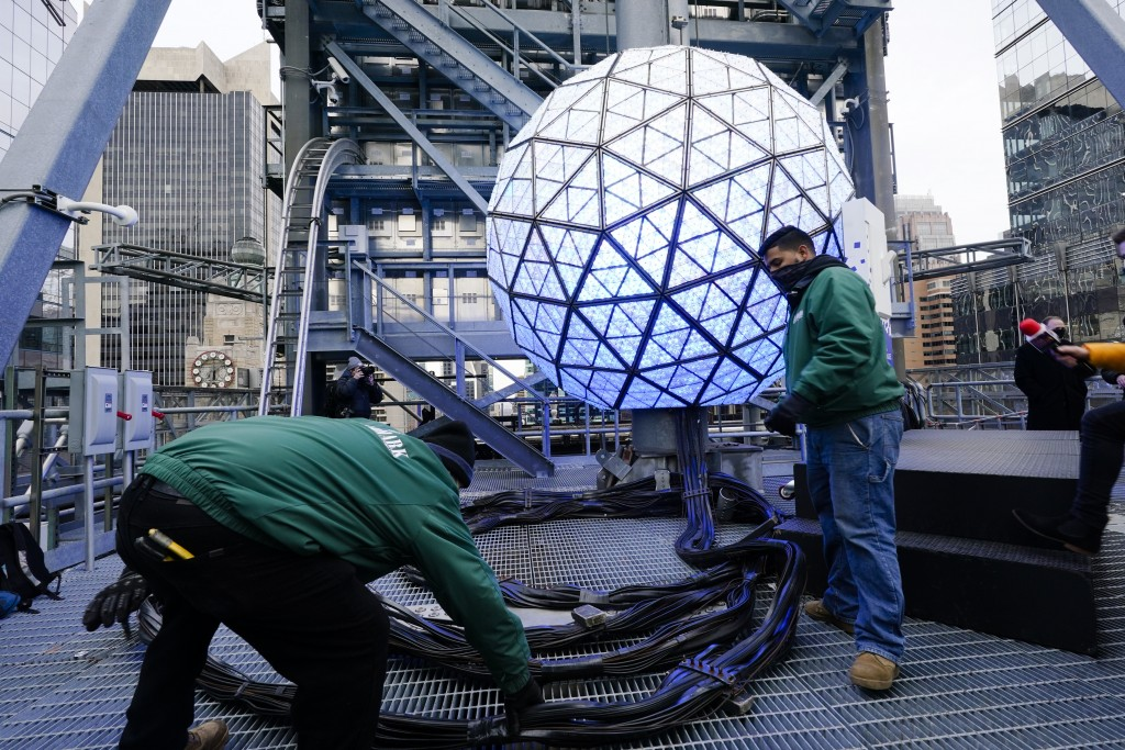 Event organizers test the New Year's Eve Ball ahead of the official Times Square celebration Wednesday, Dec. 30, 2020, in New York. (AP Photo/Frank Fr...
