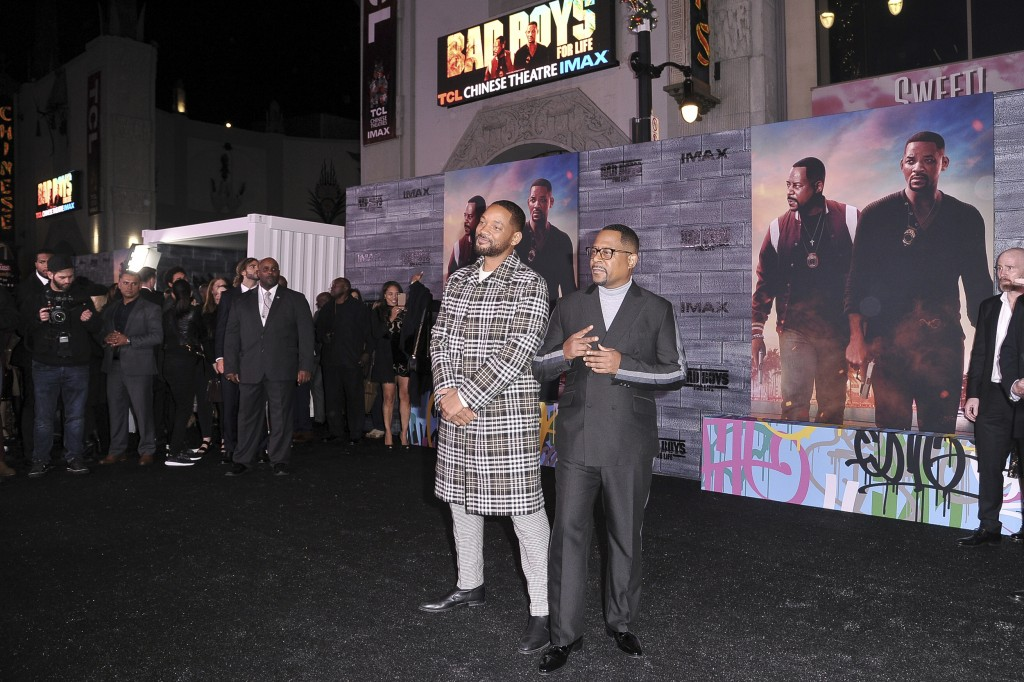 """FILE - In this Jan. 14, 2020, Will Smith, left, and Martin Lawrence attend the LA premiere of """"Bad Boys for Life"""" at the TCL Chinese Theatre in Los An..."""