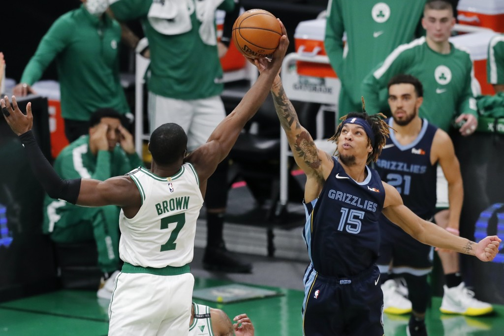 Boston Celtics' Jaylen Brown (7) and Memphis Grizzlies' Brandon Clarke (15) battle for a rebound during the first half of an NBA basketball game, Wedn...