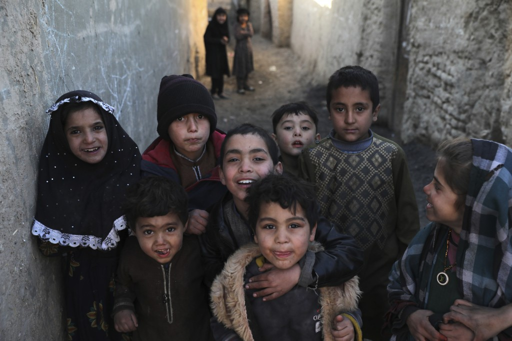Internally displaced children pose for a photograph outside their temporary home in the city of Kabul, Afghanistan, Wednesday, Dec. 30, 2020. Save the...
