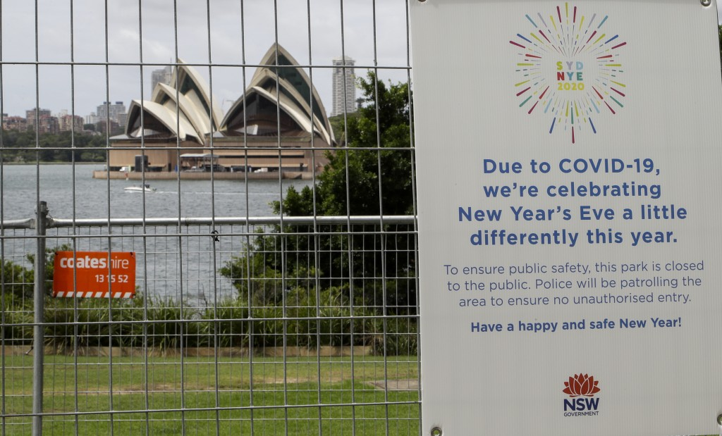 A signs adorns a security fence near the Sydney foreshore ahead of New Years Eve in Sydney, Australia, Thursday, Dec. 31, 2020. One million people wou...