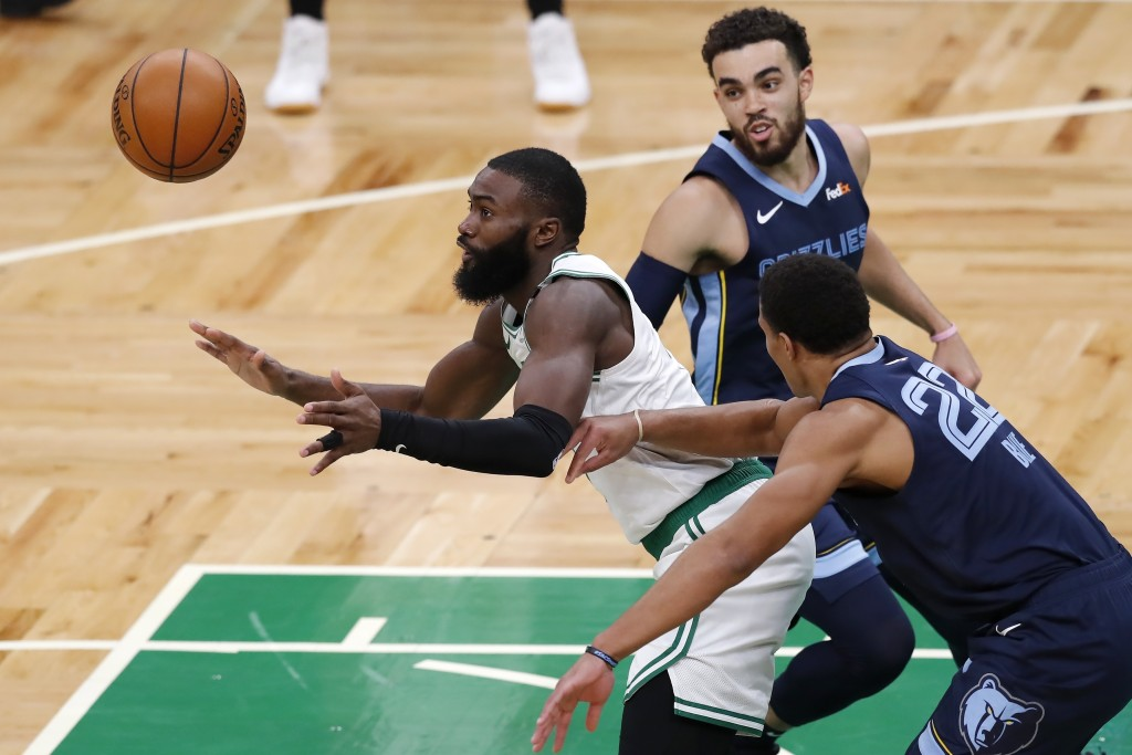 Boston Celtics' Jaylen Brown looses control of the ball to Memphis Grizzlies' Desmond Bane (22) during the first half of an NBA basketball game, Wedne...