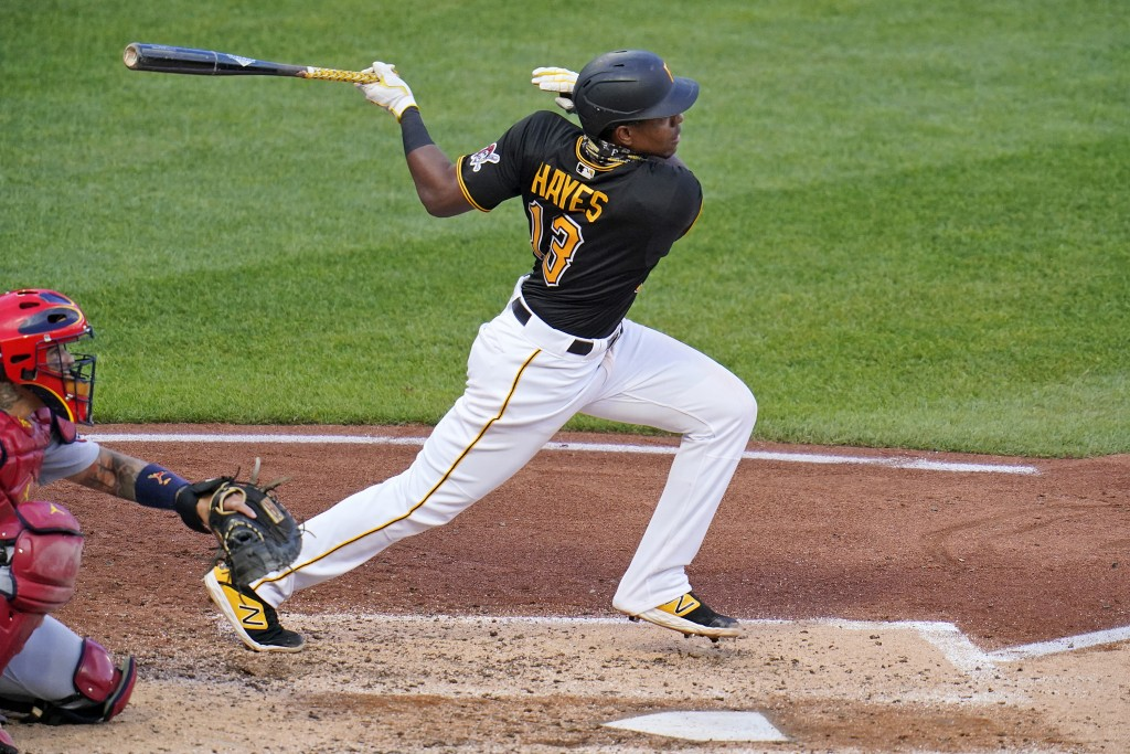 FILE - Pittsburgh Pirates' Ke'Bryan Hayes, right, drives in two runs with a single to right field off St. Louis Cardinals starting pitcher Carlos Mart...