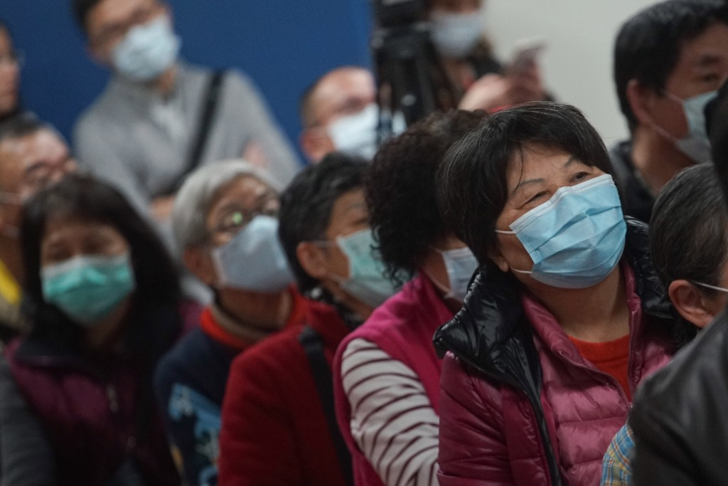 People in Taipei wear face masks.