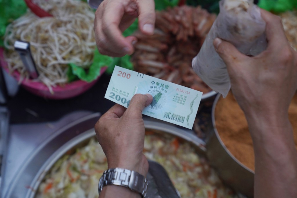 Consumer buys street food with stimulus voucher.