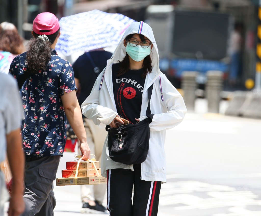 Temperatures in Taipei reached a record 39.7 C Friday.