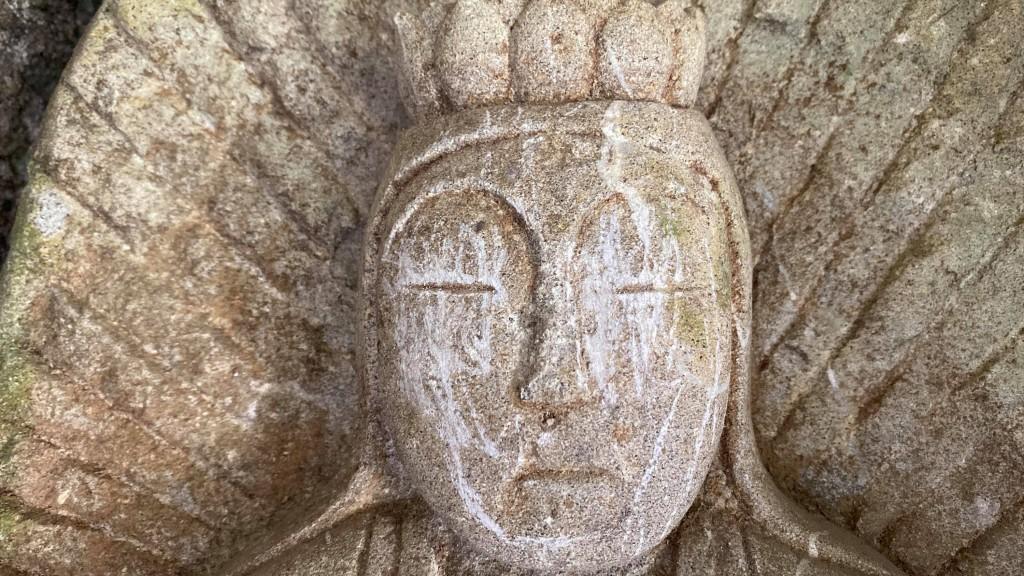Damaged Buddha statue in the Taroko National Park