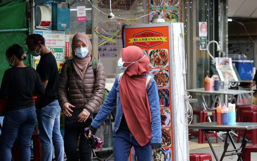 Stock image of migrant workers on Taipei street.