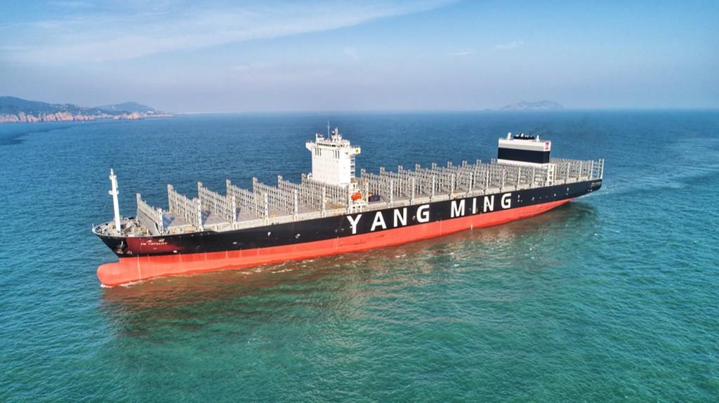 A Yang Ming cargo ship sets sail.