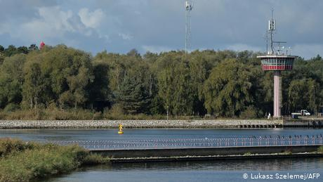 A yellow bouy marks the exact spot where a World War II bomb lies in the Piast Canal