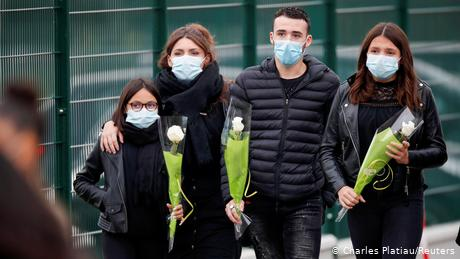 Several people brought flowers to the Bois d'Aulne college after the attack, near Paris