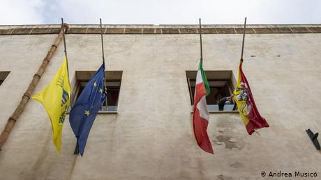 Flags are displayed at half-mast on the city hall building of Mazara del Vallo for the fishermen detained in Libya