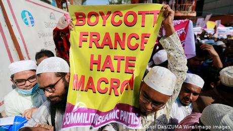 France's Emmanuel Macron seeks to calm tensions with Muslims