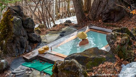 A woman bathing in an onsen at a guesthouse in Matsumoto, Japan