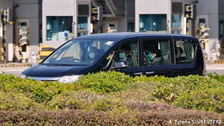 One of the 12 activists is seen in a vehicle after a transfer conducted at the China-Hong Kong border of Shenzhen Bay Port