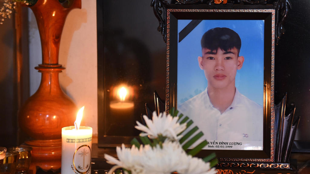 A portrait of 20-year-old Nguyen Dinh Luong, who was among  the 39 people found dead in a truck in Britain, is kept on a prayer altar at his house in ...